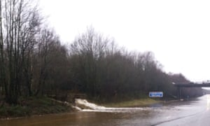 Flooding at the M23 as a river has burst its banks and is flowing down on to the carriageway.