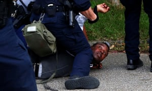 A demonstrator is detained during protests in Baton Rouge, Louisiana, July 10, 2016.