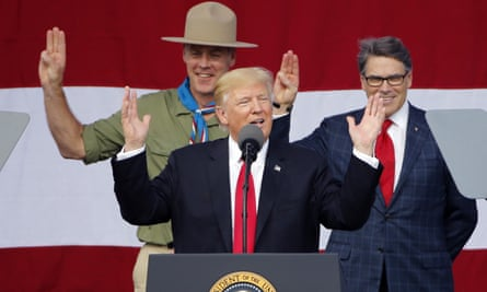 Climate scientists say a policy enacted by US interior secretary Ryan Zinke, pictured with Donald Trump and Rick Perry, is holding up scientific research funding.