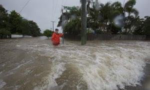 Amelia Rankin in floodwaters in Hermit Park, Townsville