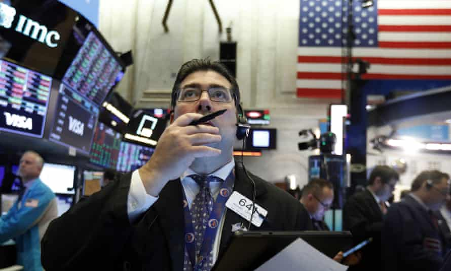 A trader on the floor of the New York stock exchange