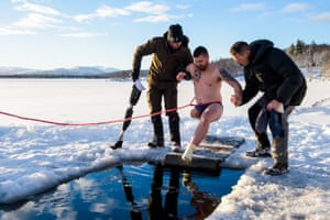 Baz Barratt enters an ice hole during a respite holiday in Norway organised by the Royal Marines Club on 4 December 2018. He lost his leg and suffered severe damage to his hands in an IED explosion in Afghanistan in 2008