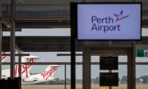perth airport sign and planes in the background