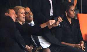 Obama and Cameron pose for a selfie taken by Denmark's then prime minister, Helle Thorning-Schmidt, during the memorial service of Nelson Mandela on 10 December 2013