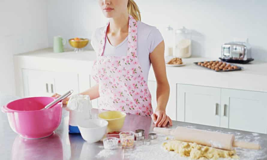Woman preparing to make biscuits<br>GettyImages-56166334 housewife wearing apron in kitchen