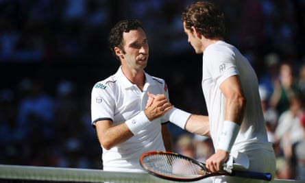 Andy Murray shakes hands with Mikhall Kukushkin, after winning in straight sets.