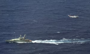An Australian navy boat shadows a boat believed to be carrying up asylum seekers off Indonesia.