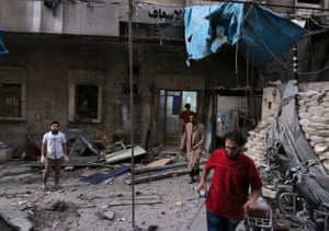 Medics inspect the damage outside a field hospital after an airstrike in the rebel-held al-Maadi neighbourhood