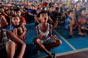 Children celebrate during a live public viewing after Manny Pacquiao beat Keith Thurman in a WBA welterweight fight.