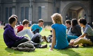 Happy students on grass