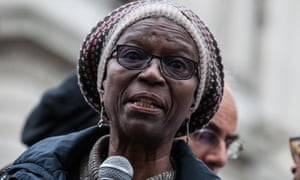 Ajibola Lewis, the mother of Olaseni Lewis, addresses campaigners after a procession to Downing Street.