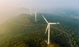 Aerial view of wind turbines on land