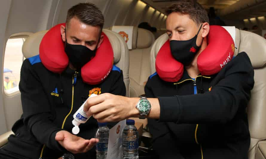 Tom Heaton (left) and Nemanja Matic get busy with the hand gel on the way to Switzerland.