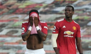 Fred (left) and Paul Pogba struggle to come to terms with Manchester United's evisceration by Spurs.