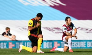 Troy Deeney takes a knee in support of the Black Lives Matter movement before Watford's match at Burnley.