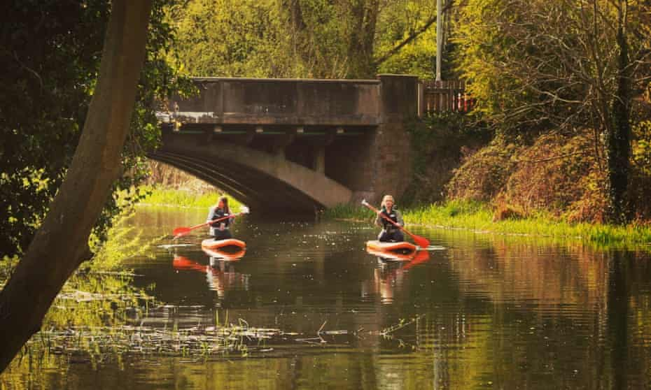 paddleboarding on the River Wensum near Norwich.