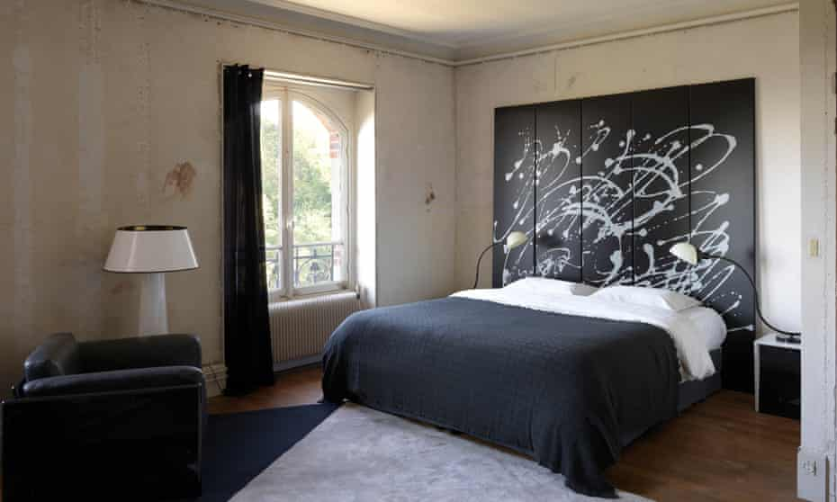 Dream on: action-filled artwork in the bedroom.