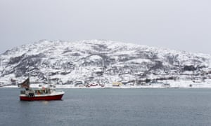 A fishing boat returns from a trip to the Barents Sea to the tiny port of Sommaroya, northern Norway