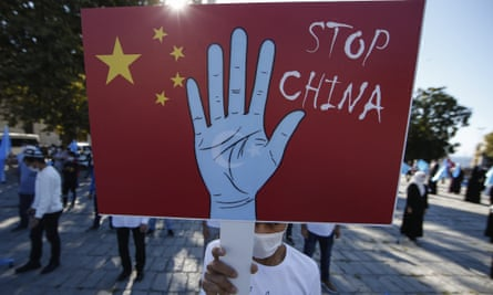 A protester from the Uighur community holds an anti-China placard during a protest in Istanbul on Friday. More than one million people from the Uighur and Turkic Muslim communities in Xinjiang are believed to have been detained in internment camps since 2017.