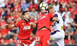 Ersan Gulum gets his head to the ball during the match between Adelaide United and the Perth Glory at Coopers Stadium.