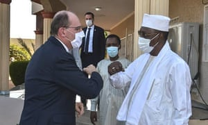 French prime minister Jean Castex (L) is elbow greeted by Chadian president Idriss Deby at the latter's winter residence in Amdjarass, capital of the province of Ennedi-East on 31 December, 2020, where he has also spent New Year's Eve with French soldiers deployed in Sahel.