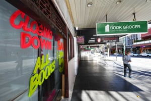 Closing down singage is seen on a window of a retail store along Bourke Street Mall in Melbourne on Monday.