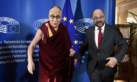 The Dalai Lama (left) is welcomed by Martin Schulz
