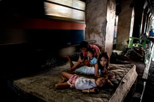 A family living along a train track in Manila.