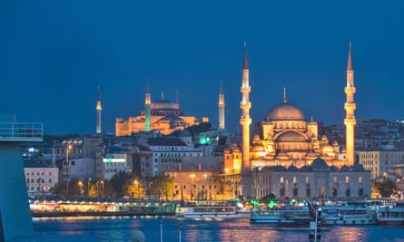 Side by side … Istanbul's Yeni Cami ('new mosque') in front of Hagia Sophia, a former cathedral.