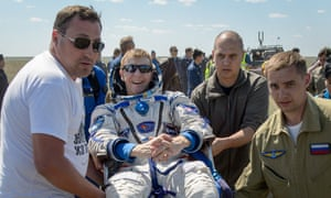 Tim Peake is carried to a medical tent after the landing in Kazakhstan.