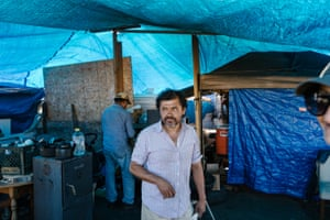 Roberto Lopez inside the kitchen at the Community of Grace encampment near a Home Depot in Oakland.
