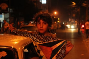 A girl holding a Palestinian flag