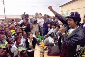 Winnie shouts amandla (power) to greet a crowd at a squatter camp near Centurion