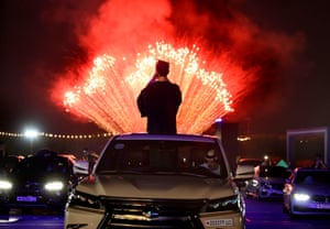 High-school seniors and their families watch fireworks at the Sakhir racetrack in Bahrain