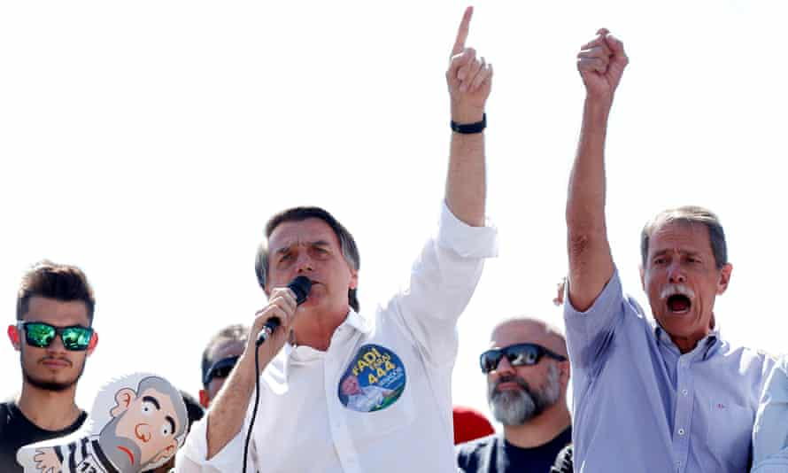 The rise of Brazil's presidential candidate Jair Bolsonaro, center, owes much to WhatsApp.