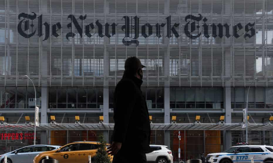 A person wears a protective face mask outside the New York Times building.