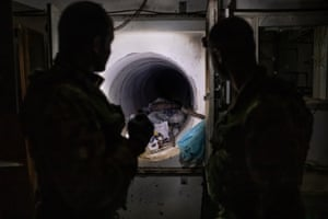 The Squadrone Carabinieri Eliportato 'Cacciatori Calabria' during a night mission in the bathroom of a bunker house where a tunnel has been built.