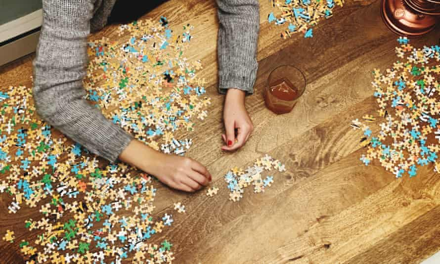 Cropped Hands Of Woman Playing Jigsaw