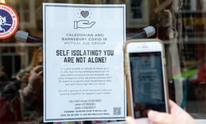 Support for self-isolators: flyers posted by volunteers in Islington, north London.