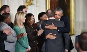 US President Barack Obama(R) embraces Mark Barden, father of Daniel, a Sandyhook Elementary School shooting victim, after he introduced the President prior to his speech on reducing gun violence in the East Room of the White House on January 5, 2016 in Washington, DC. AFP PHOTO/MANDEL NGANMANDEL NGAN/AFP/Getty Images