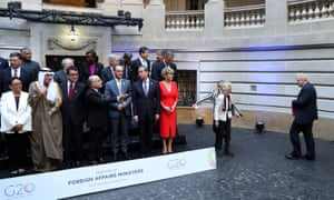 Boris Johnson (right) arrives for the official photo with foreign ministers and representatives at the G20 Meeting of foreign affairs ministers in Buenos Aires, Argentina.