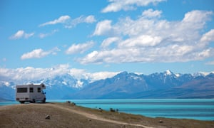 tourist van overlooking lake and mountains
