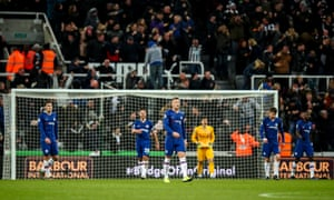 Dejected players of Chelsea after conceding a goal to make it 1-0.