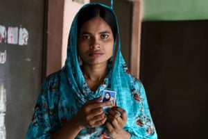 Tania holds the only photograph she has of her daughter, who she only sees twice a year.
