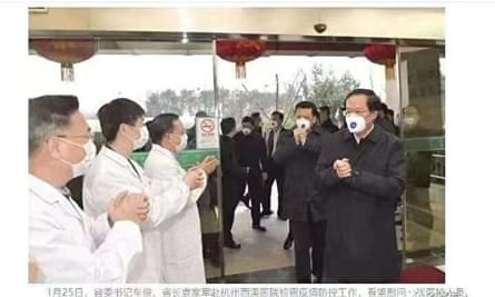 A screenshot from Weibo showing officials wearing specialised N95 respirator masks.