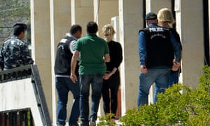 Lebanese police escort Sally Faulkner (centre, in black) and 60 Minutes reporter Tara Brown (right) from court in Beirut
