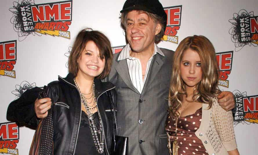 Bob Geldof with Pixie one side of him and Peaches the other, an arm around each daughter.