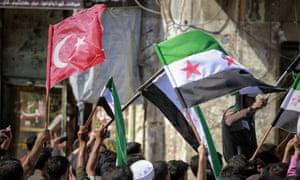 The Turkish flag among those waved in Idlib