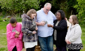 Lorna and Graham Trow with Clare (20, second left), Ayisha (27, left) and Joanne (33, right), residents with learning disabilities who are cared for in ordinary families