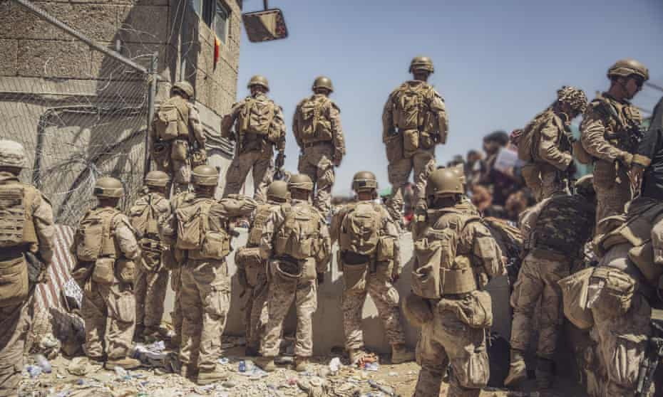 Marines assist with security at a checkpoint during an evacuation at Hamid Karzai International Airport in Kabul.